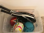 Tennis racquets and various sports balls