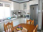 Fully equipped kitchen with stove, brand new fridge with freezer, toaster, kettle and microwave.