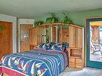 This bedroom offers a queen bed.