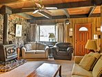 The charming living room offers a flat-screen & ornamental wood-burning stove.
