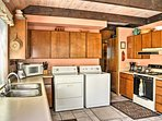 The fully equipped kitchen provides all the cooking essentials and laundry units.
