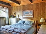 Enjoy some much-needed rest in this cozy bedroom with a queen bed.