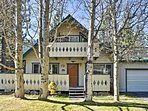 This charming vacation cabin boasts easy access to nearby ski areas & Lake Tahoe.
