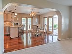 The kitchen area is adorned with handsome hardwood floors