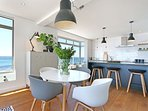 Big kitchen island and cafe-style table