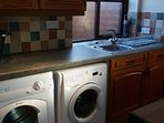 Utility room with washing machine, tumble dryer, sink etc