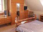 Bedroom 1 with kingsize double bed, en-suite, tv