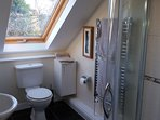 En-suite to Bedroom 1 with shower, toilet, basin