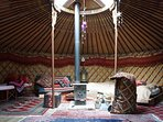 A lovely wood burner in the centre of the yurt keeps you toasty in all weathers!