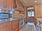 Master Chef's Kitchen with Viking Gas Stove, Sub Zero Refrigerator and Den Seating