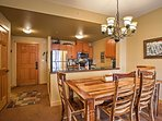 Gather around the stately dining table to enjoy your home cooked meals as a group.