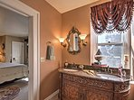 The en-suite master bathroom is truly fit for royalty!