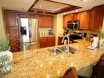 Gorgeous and fully stocked kitchen - spice rack, coffee and view of the Gulf!