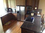Gourmet kitchen with Jen-Air range, Kitchenaid mixer, fully stocked with all cooking/eating utensils