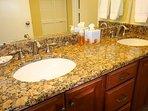 Granite double sink counters serving master bedroom.