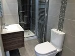 Ensuite to master bedroom with shower, washbasin, wc, LED mirror and shaver point