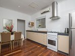 Refreshed kitchen with reverse cycle air con