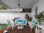 Outdoor patio with comfy white cane suite