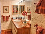 Freshen up for the day in this pristine bathroom.