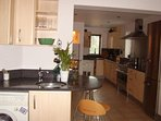 Kitchen has utility area convenient to garden doors
