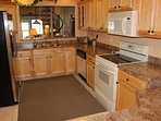 Beautiful, fully equipped kitchen with granite counter tops.