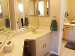 Master bath with separate vanity, walk-in closet, with additional vanity with walk-in shower.