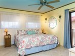 Bedroom has King size bed and abundant storage space.