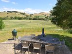 Outdoor dining table with views of the polo field and rolling hills