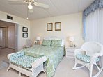 Master bedroom with queen bed, large mirrored dressing room and ample closet / storage space.