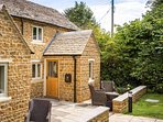 The cottage has a private patio area and shares the lovely communal gardens