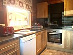 Kitchen with Induction Hob, Oven, Microwave, Dishwasher, Fridge Freezer, Kettle and Toaster