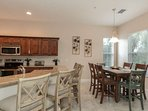 Enjoy meals gathered round the kitchen or in the adjacent morning room overlooking the preserve