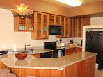 Full Gourmet Kitchen with Fridge, Dishwasher, Dishes, Cookware and Utensils.