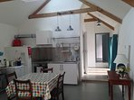 Kitchen and dining areas - fridge, electric stove, gas hob, extractor fan and sink