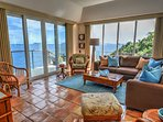 Living room with unobstructed views looking down island, and Sonos sound system.