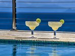 Enjoy a Margarita, while sitting in the pool, looking at the panoramic down island ocean views.
