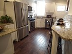 Large kitchen with dining bar, granite counter tops, all new applicances