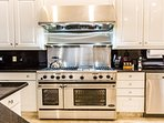 Professional Chef's 6 Burner Stove with Dual Ovens, Griddle, & Warmer Lights.