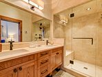 Bathroom space isn't either in the guest master en suite, with its dual sinks and walk-in shower.