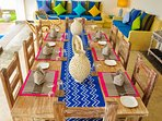 Our handcrafted dining table sets 10 comfortably...perfect for long lazy family meals.
