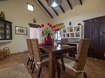 dining hall with vaulted ceiling.Large dining table & 6 seagrass chairs & built in canarian unit