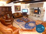 Large lounge with luxury leather seating, woodburner and large flatscreen TV