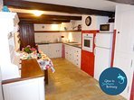 The large Breton fully equipped farmstyle kitchen