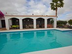 heated pool & covered terrace with jacuzzi & rattan suite &dining table & chairs seating 6 people