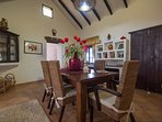 dining hall with built in Canarian unit ,rustic dining table &6 sea grass chairs