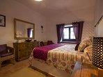 master bedroom with king size bed,double wardrobe & en suite shower room