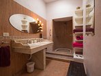 en suite bathroom to master bedroom with his n hers basins &walk in shower.