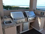 Four gas grills right on the beach