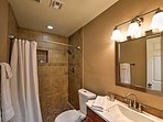 This full bathroom, located off the kitchen, is part of the home's recent remodel.