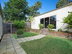 Secure courtyard, with garage at the rear.  Great playspace for children & outdoor eating.